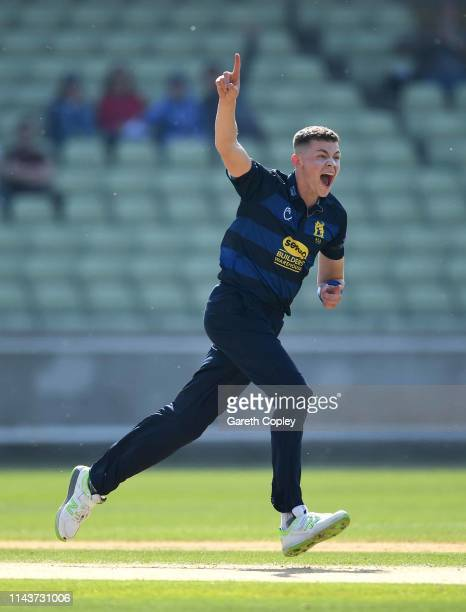 Henry Brookes of Warwickshire celebrates dismissing Adam Lyth of Yorkshire during the Royal London One Day Cup match between Warwickshire and...