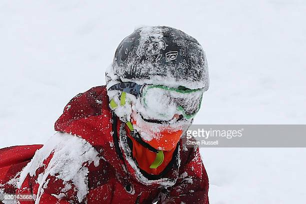TORONTO ON DECEMBER 17 Henry Burrill wipes out in the fresh powder on the hill in Riverdale Park as Toronto digs out copes and enjoys the first big...