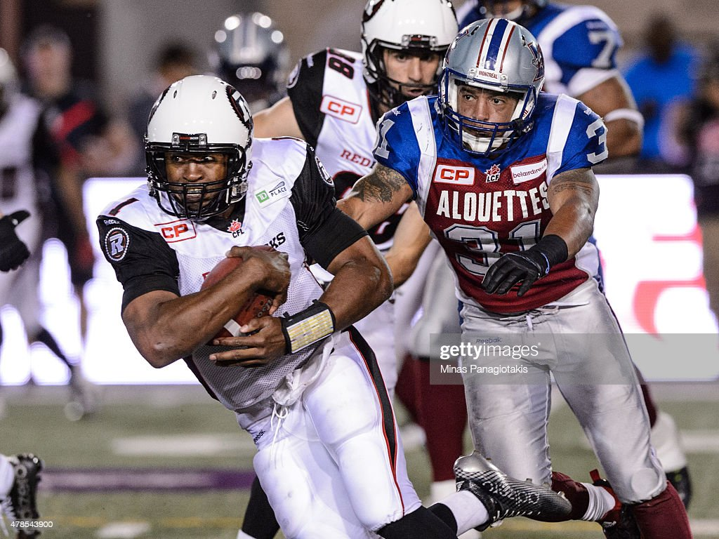 Henry Burris #1 of the Ottawa Redblacks tries to move the ball past Winston Venable #31 of the Montreal Alouettes during the CFL game at Percival Molson Stadium on June 25, 2015 in Montreal, Quebec, Canada. The Ottawa Redblacks defeated the Montreal Alouettes 20-16.