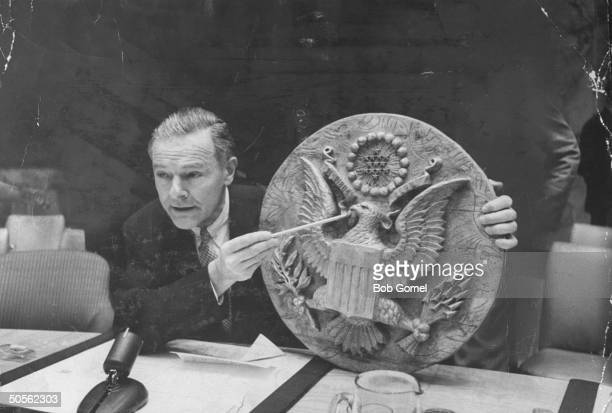 Henry Cabot Lodge Jr displaying bugged plaque that was found in the US Embassy