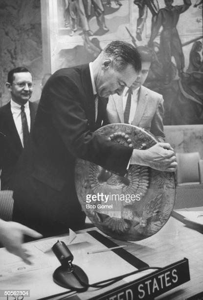 Henry Cabot Lodge Jr showing bugged eagle plaque in which Soviets planted in US Embassy