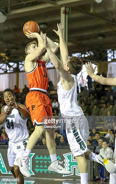 Henry Caruso of the Princeton Tigers shoots a jump shot over Matthew Owies of the Hawaii Rainbow Warriors during the first half of the Pearl Harbor...
