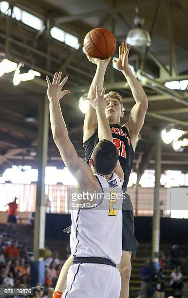Henry Caruso of the Princeton Tigers shoots over Sam Singer of the California Golden Bears during the first half of the Pearl Harbor Invitational...