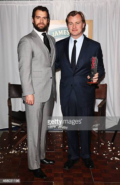 Henry Cavill and Christopher Nolan with the Best Director Award at the Jameson Empire Awards 2015 at the Grosvenor House Hotel on March 29 2015 in...