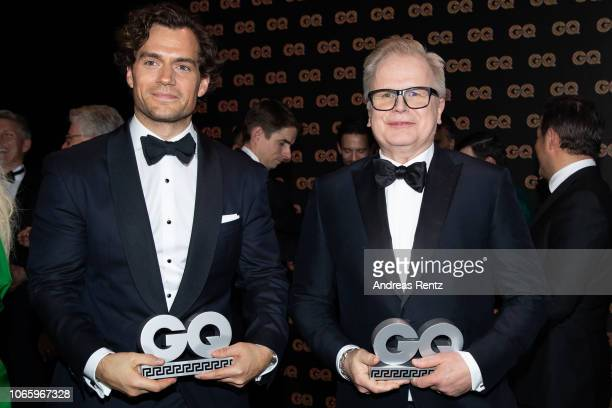 Henry Cavill and Herbert Groenemeyer pose with their awards on stage during the GQ Men of the Year Award show at Komische Oper on November 08 2018 in...