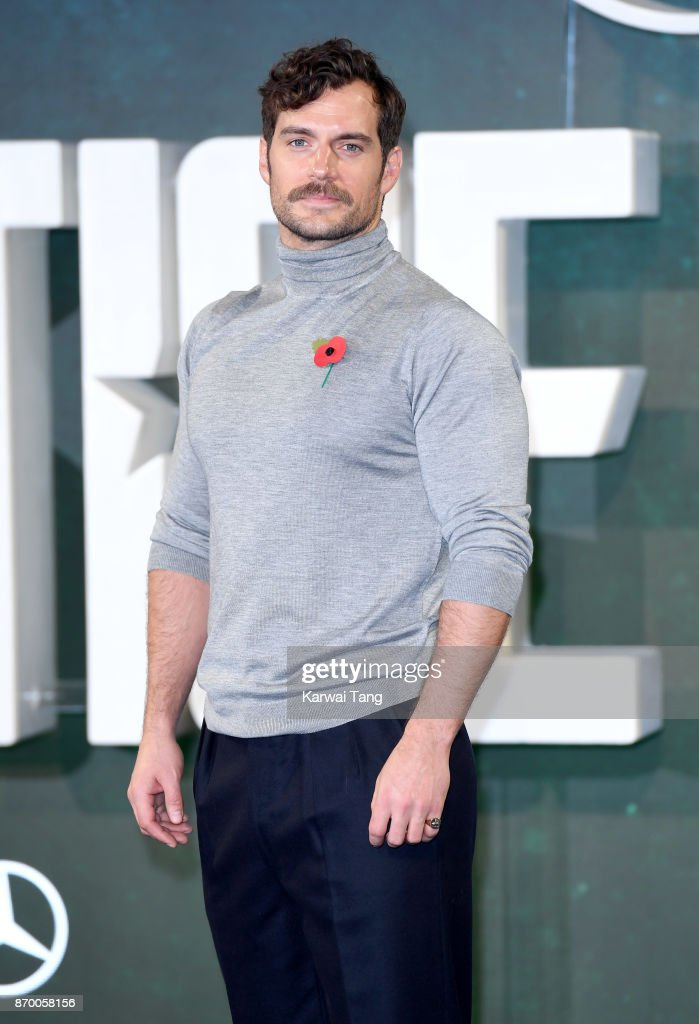 Henry Cavill attends the 'Justice League' photocall at The College on November 4, 2017 in London, England.