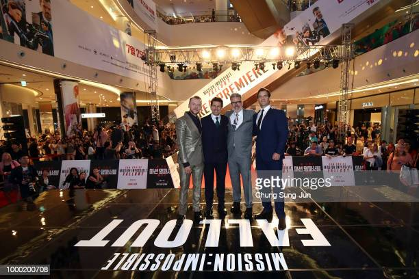 Henry Cavill Christopher McQuarrie Tom Cruise and Simon Pegg attend the 'Mission Impossible Fallout' Seoul Premiere at Lotte World Mall on July 16...