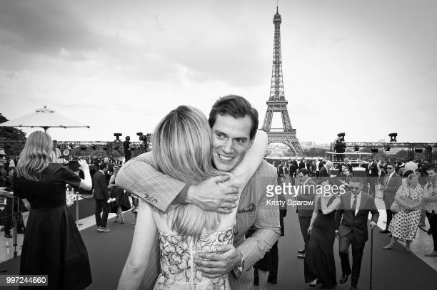 Henry Cavill hugs Alix Benezech prior to the Global Premiere of 'Mission Impossible Fallout' at Palais de Chaillot on July 12 2018 in Paris France