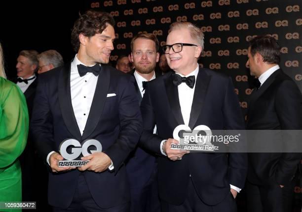 Henry Cavill Movie International Awardwinner and Herbert Groenemeyer Legend Awardwinner are seen on stage during the GQ Men of the Year Award show at...