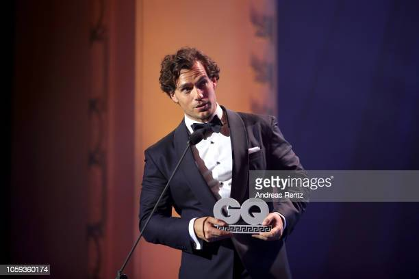 Henry Cavill speaks on stage after receiving his award during the GQ Men of the Year Award show at Komische Oper on November 8, 2018 in Berlin,...