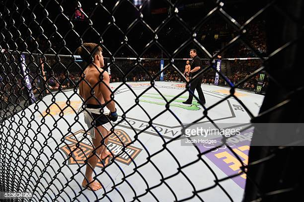 Henry Cejudo and Demetrious Johnson face off before their flyweight championship bout during the UFC 197 event inside MGM Grand Garden Arena on April...