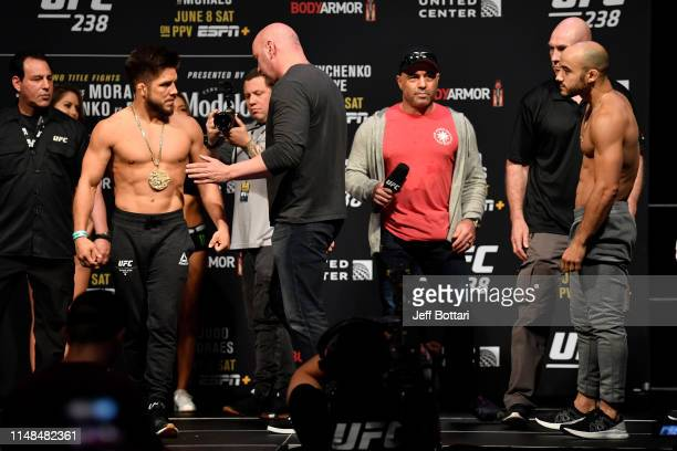 Henry Cejudo and Marlon Moraes of Brazil face off during the UFC 238 weighin at the United Center on June 7 2019 in Chicago Illinois