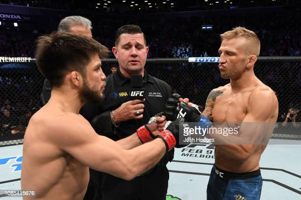 Henry Cejudo and TJ Dillashaw touch gloves prior to their flyweight bout during the UFC Fight Night event at the Barclays Center on January 19 2019...