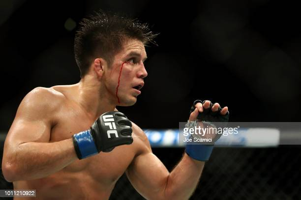 Henry Cejudo bleeds from the head in the third round against Demetrious Johnson in the UFC Flyweight Title Bout during UFC 227 at Staples Center on...