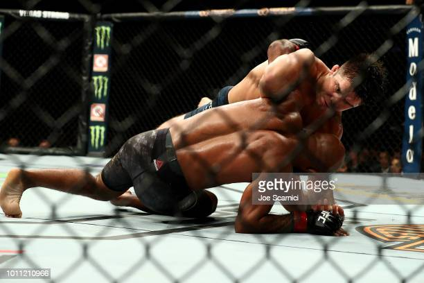 Henry Cejudo brings Demetrious Johnson to the ground in the third round of the UFC Flyweight Title Bout during UFC 227 at Staples Center on August 4...