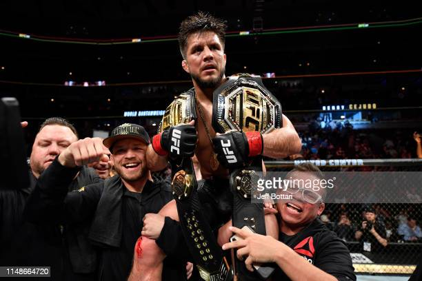 Henry Cejudo celebrates his TKO victory over Marlon Moraes of Brazil in their bantamweight championship bout during the UFC 238 event at the United...