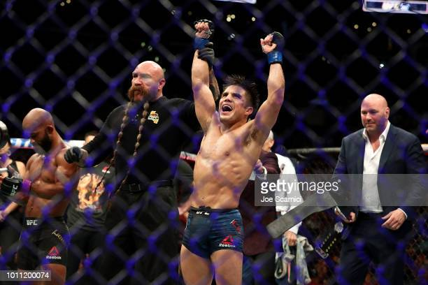 Henry Cejudo celebrates his UFC Flyweight Title Bout win over Demetrious Johnson during UFC 227 at Staples Center on August 4 2018 in Los Angeles...
