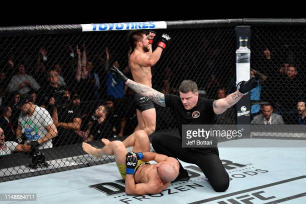 Henry Cejudo celebrates his victory over Marlon Moraes of Brazil in their bantamweight championship bout during the UFC 238 event at the United...