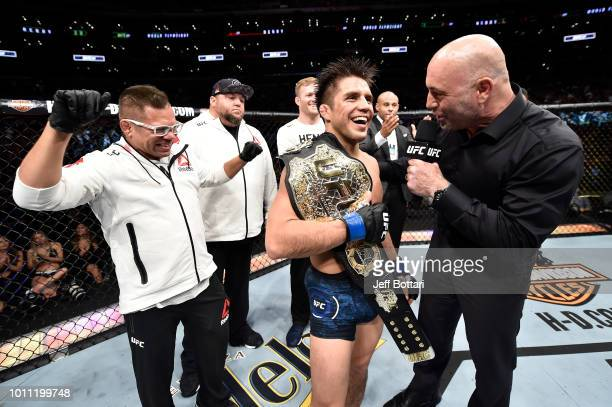 Henry Cejudo is interviewed by Joe Rogan after his splitdecision victory over Demetrious Johnson in their UFC flyweight championship fight during the...