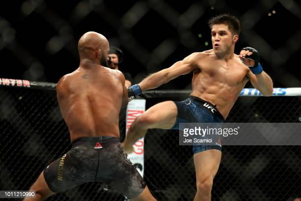 Henry Cejudo kicks Demetrious Johnson in the second round of the UFC Flyweight Title Bout during UFC 227 at Staples Center on August 4 2018 in Los...