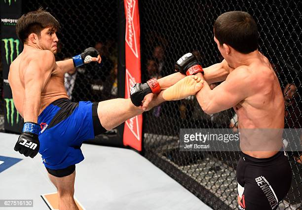 Henry Cejudo kicks Joseph Benavidez in their flyweight bout during The Ultimate Fighter Finale event inside the Pearl concert theater at the Palms...