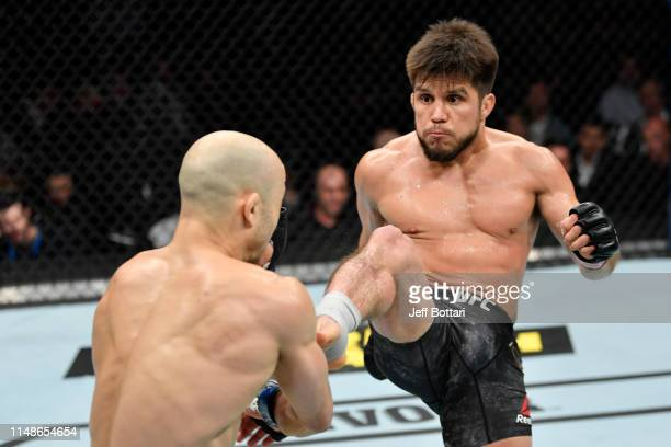 Henry Cejudo kicks Marlon Moraes of Brazil in their bantamweight championship bout during the UFC 238 event at the United Center on June 8 2019 in...