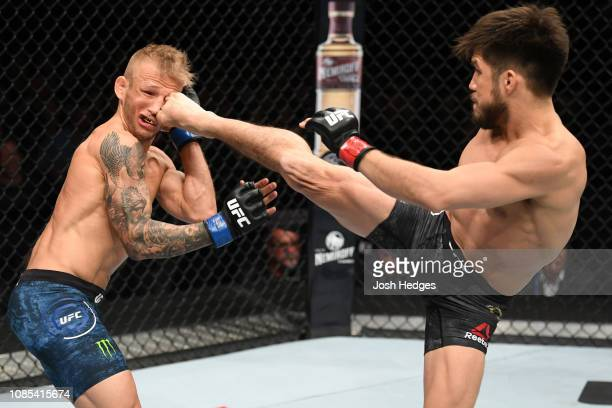 Henry Cejudo kicks TJ Dillashaw in their flyweight bout during the UFC Fight Night event at the Barclays Center on January 19 2019 in the Brooklyn...