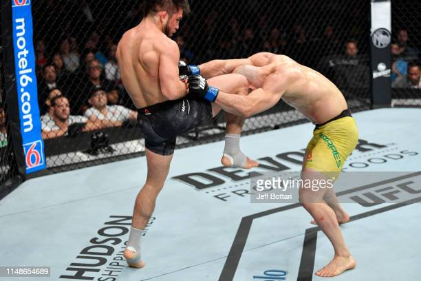 Henry Cejudo knees Marlon Moraes of Brazil in their bantamweight championship bout during the UFC 238 event at the United Center on June 8 2019 in...