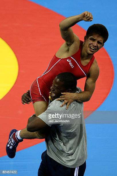 Henry Cejudo of the United States celebrates after defeating Shingo Matsumoto of Japan to win the gold medal in the men's 55kg freestyle wrestling...