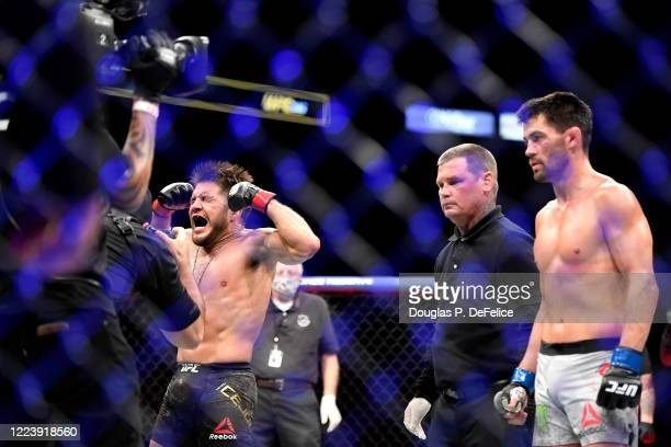 Henry Cejudo of the United States celebrates defeating Dominick Cruz of the United States in their bantamweight title fight during UFC 249 at VyStar...