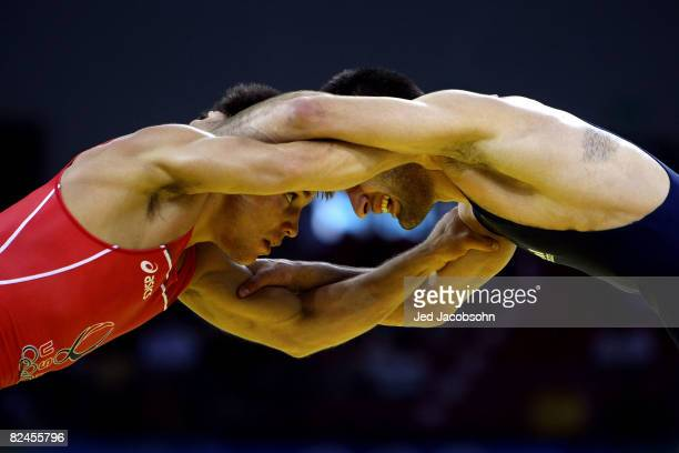 Henry Cejudo of the United States competes against Besarion Gochashvili of Georgia during the 55kg freestyle wrestling event at the China Agriculture...