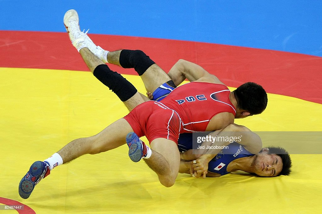 Henry Cejudo (red) of the United States competes against Shingo Matsumoto of Japan for the gold medal in the men's 55kg freestyle wrestling event at the China Agriculture University Gymnasium on Day 11 of the Beijing 2008 Olympic Games on August 19, 2008 in Beijing, China.