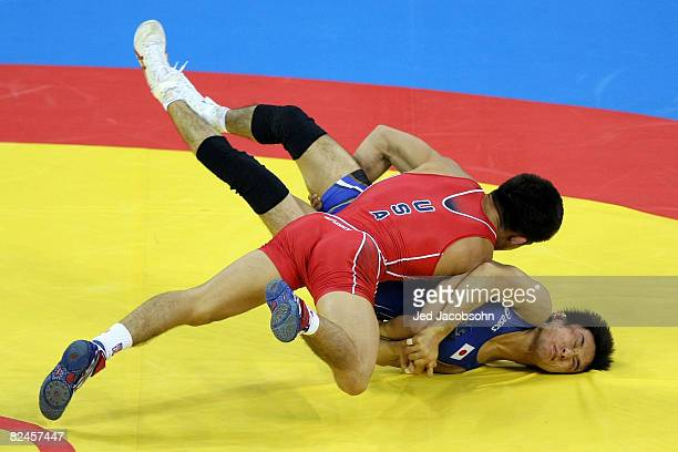 Henry Cejudo of the United States competes against Shingo Matsumoto of Japan for the gold medal in the men's 55kg freestyle wrestling event at the...