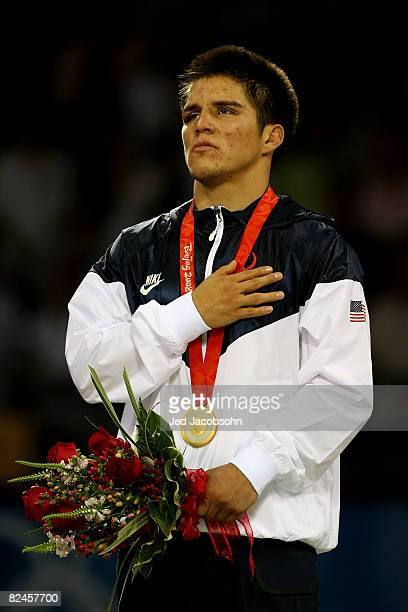 Henry Cejudo of the United States looks on during the national anthem after defeating Shingo Matsumoto of Japan to win the gold medal in the men's...