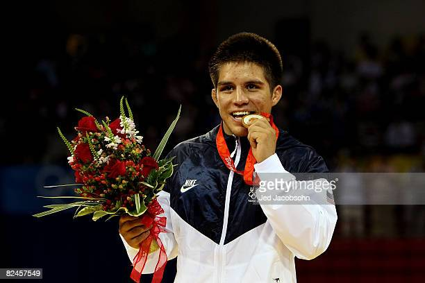 Henry Cejudo of the United States poses with his medal after defeating Shingo Matsumoto of Japan to win the gold medal in the men's 55kg freestyle...