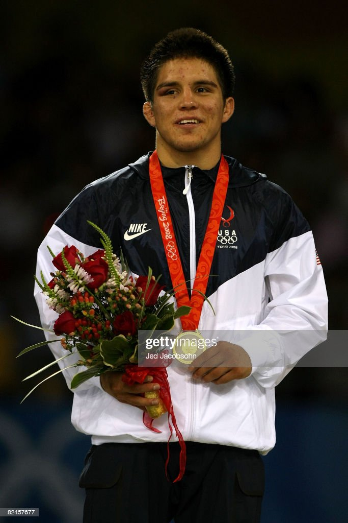 Henry Cejudo of the United States poses with his medal after defeating Shingo Matsumoto of Japan to win the gold medal in the men's 55kg freestyle wrestling event at the China Agriculture University Gymnasium on Day 11 of the Beijing 2008 Olympic Games on August 19, 2008 in Beijing, China.