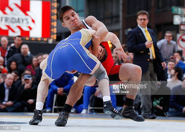 Henry Cejudo of USA battles Rasul Mashezov of Russia in USA vs Russia freestyle wrestling during the 2011 Beat The Street Gala on May 5 2011 in Times...
