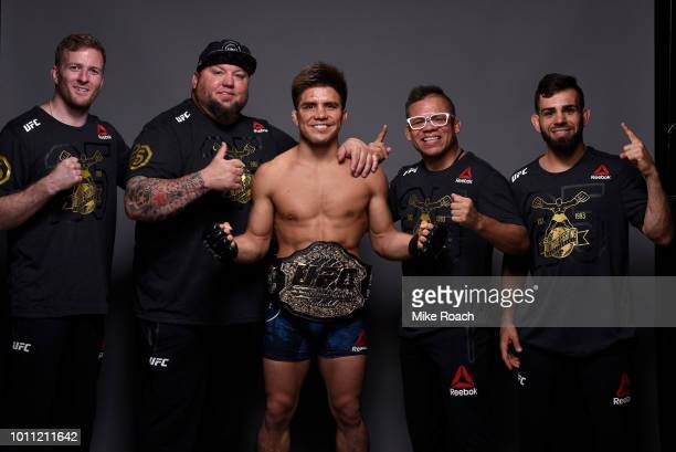 Henry Cejudo poses for a portrait backstage with his team after his victory over Demetrious Johnson during the UFC 227 event inside Staples Center on...