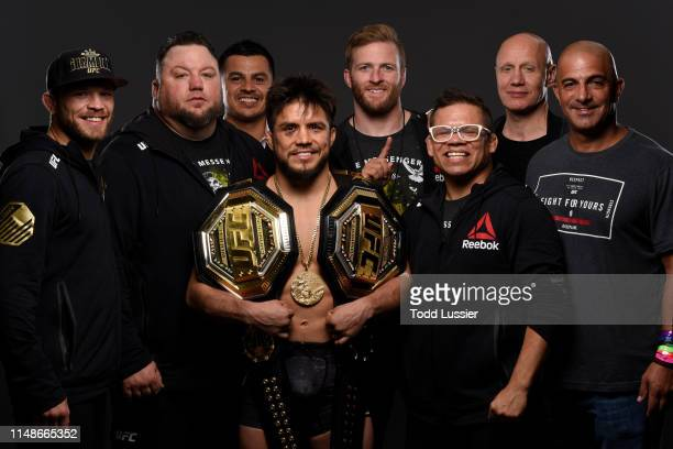 Henry Cejudo poses for a portrait backstage with his team during the UFC 238 event at the United Center on June 8 2019 in Chicago Illinois