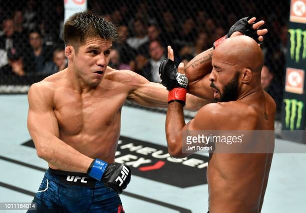 Henry Cejudo punches Demetrious Johnson in their UFC flyweight championship fight during the UFC 227 event inside Staples Center on August 4 2018 in...