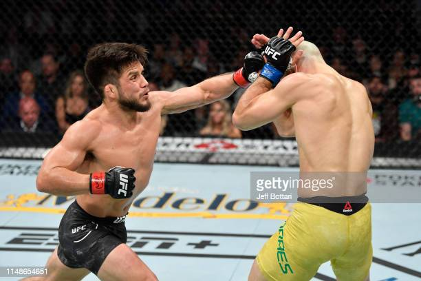 Henry Cejudo punches Marlon Moraes of Brazil in their bantamweight championship bout during the UFC 238 event at the United Center on June 8 2019 in...