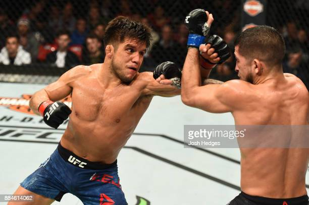 Henry Cejudo punches Sergio Pettis in their flyweight bout during the UFC 218 event inside Little Caesars Arena on December 02 2017 in Detroit...