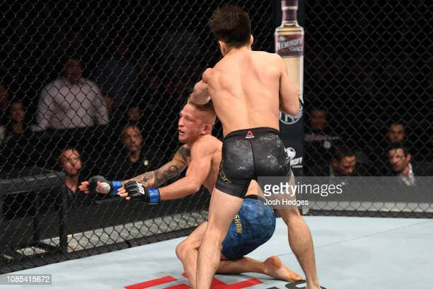 Henry Cejudo punches TJ Dillashaw in their flyweight bout during the UFC Fight Night event at the Barclays Center on January 19 2019 in the Brooklyn...