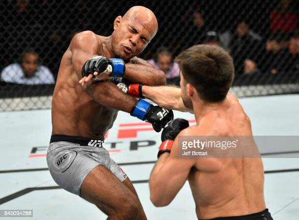 Henry Cejudo punches Wilson Reis of Brazil in their flyweight bout during the UFC 215 event inside the Rogers Place on September 9 2017 in Edmonton...