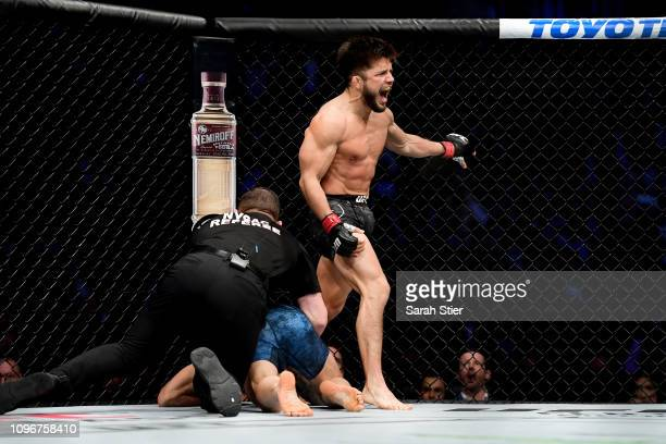 Henry Cejudo reacts after the judge's decision to halt the match giving Cejudo the win in his UFC Flyweight title match against TJ Dillashaw at UFC...