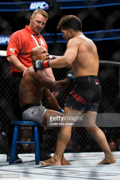 Henry Cejudo right congratulates his defeated opponent Wilson Reis during UFC 215 at Rogers Place on September 9 2017 in Edmonton Canada