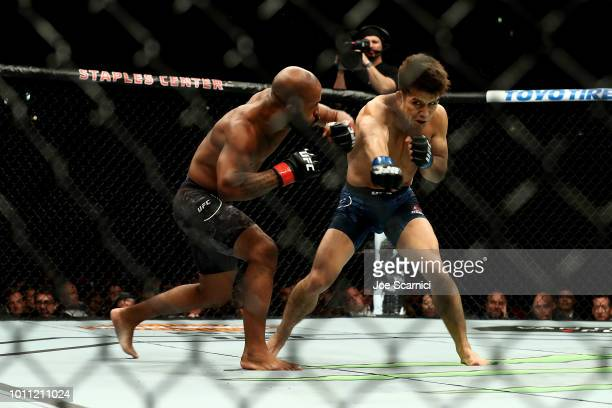 Henry Cejudo throws a punch in the first round at Demetrious Johnson in the UFC Flyweight Title Bout during UFC 227 at Staples Center on August 4...