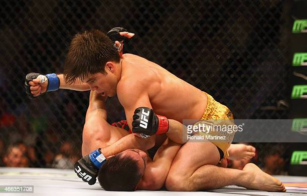 Henry Cejudo top fights with Chris Cariaso during the UFC 185 event at American Airlines Center on March 14 2015 in Dallas Texas