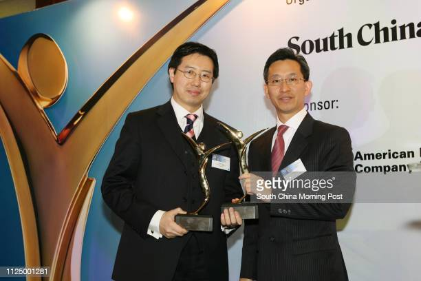 Henry Chan of Baring Asset Management receives a preformance awards from Thomas Lee Munnang vicepresident and acting assistant general manager of AIA...
