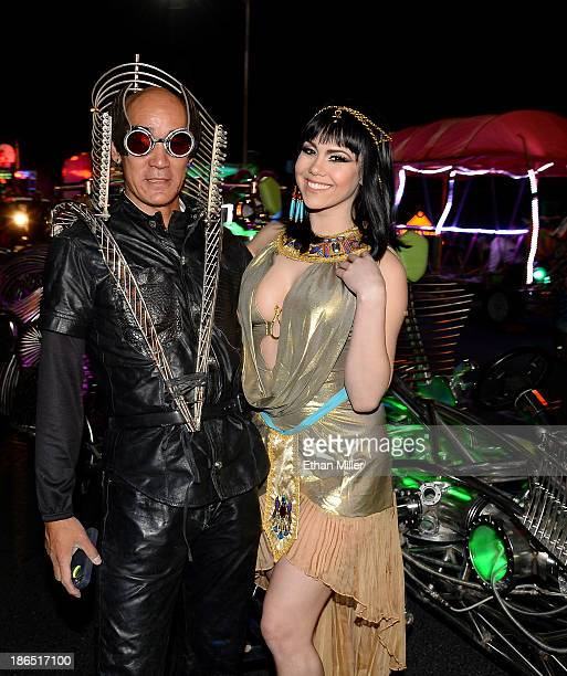 Henry Chang driver of the MisterFusion Artcar and model and parade queen Claire Sinclair attend the fourth annual Las Vegas Halloween Parade on...